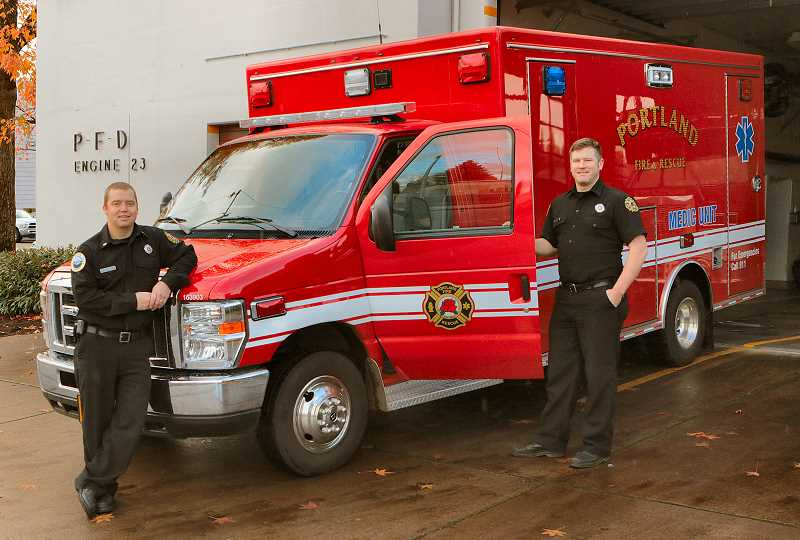 DAVID F. ASHTON - Portland Fire & Rescue Lieutenant Nicholas Weichal and Firefighter Rian Fitzpatrick show off the Type 2 emergency medical rescue vehicle now posted to serve neighborhoods in Inner Southeast Portland from the reopened Fire Station 23.