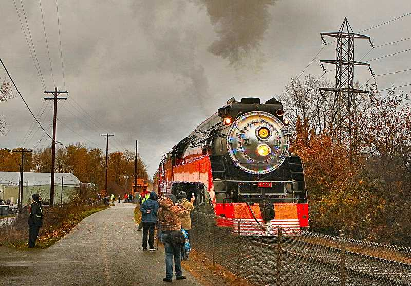 DAVID F. ASHTON - For four weekends starting at Thanksgiving every year, and ending before Christmas, the huge and historic Southern Pacific #4449 locomotive powers Holiday Express excursions north from Oaks Park, beside the Willamette River.
