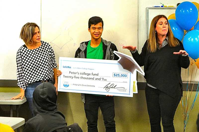 DAVID F. ASHTON - Cleveland High School senior Peter Za with a ceremonial check symbolizing his $25,000 college scholarship. He was flanked by Cleveland High School College Career Center Volunteer Jennifer Rockwood, and Sallie Mae Vice President Liz Robinson.