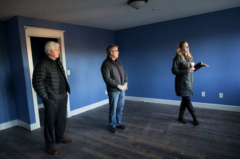 PORTLAND TRIBUNE: JAIME VALDEZ - Melissa Erlbaum, executive director of Clackamas Women's Services, walks through the nearly-finished new home for the Village of Hope it operates with Home Builders Foundation Executive Director Ken Cowdery (left) and immediate foundation past president Joe Robertson.