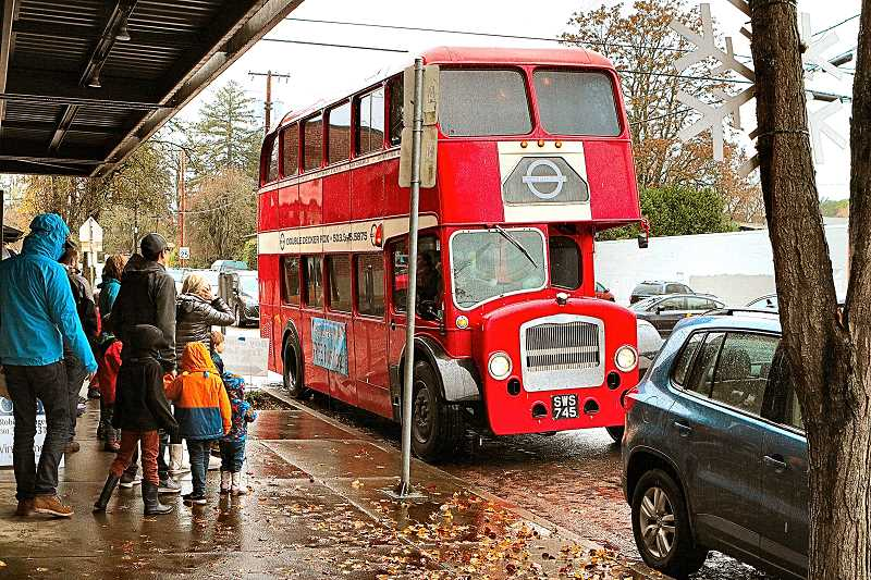 DAVID F. ASHTON - A popular feature of Decemberville this year, and an easy way to tour the entire Sellwood-Westmoreland business districts, was a free double-decker bus.