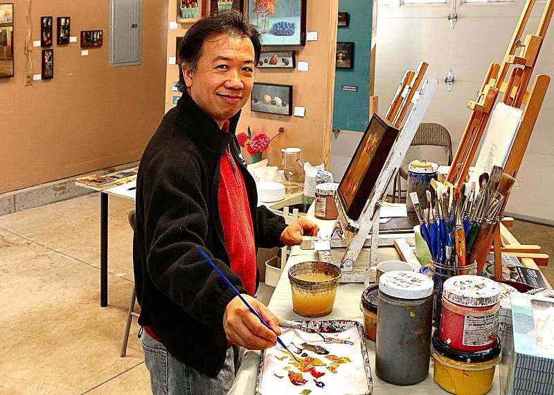 DAVID F. ASHTON - Working in his Woodstock studio, Wayne Jiang says he enjoys the process of painting.