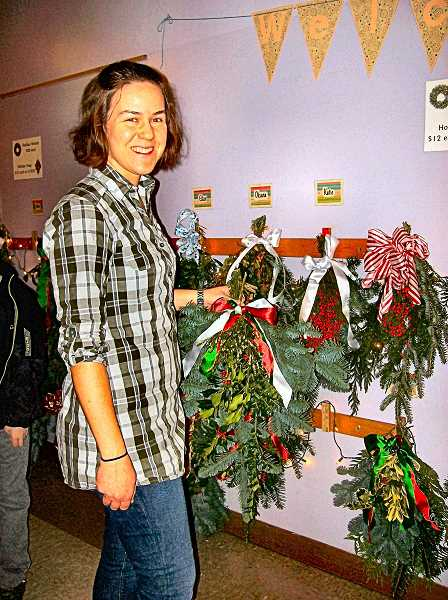 RITA A. LEONARD - Lewis Holiday Bazaar co-coordinator Foy White-Chu showed some of the Holiday swags for sale this year.