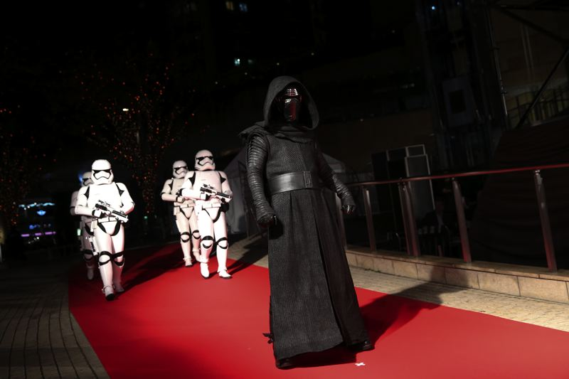 COURTESY: CHRISTOPHER JUE/GETTY IMAGES FOR DISNEY - Kylo Ren (played by Adam Driver) leads stormtroopers down the red carpet during the Japan premiere of 'Star Wars: The Last Jedi,' which is due to open in Portland theaters on Friday, Dec. 15. The movie features Mark Hamill and Carrie Fisher, who finished filming before her death in December 2016; it's a continuation of 'The Force Awakens,' and stars Driver, Daisy Ridley, John Boyega and others.