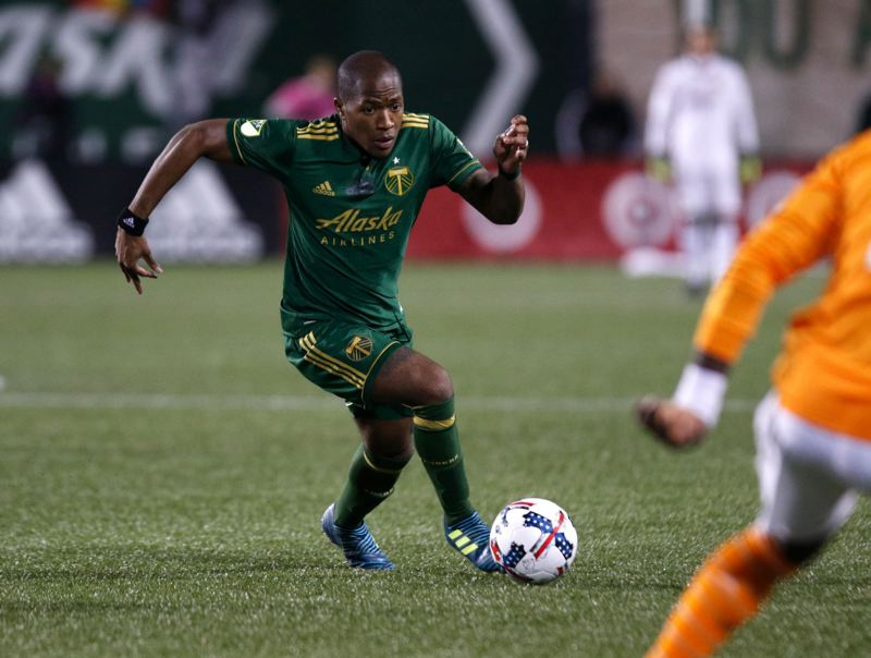TRIBUNE FILE PHOTO: JONATHAN HOUSE - Darlington Nagbe of the Portland Timbers moves forward against the Houston Dynamo during the 2017 MLS playoffs.