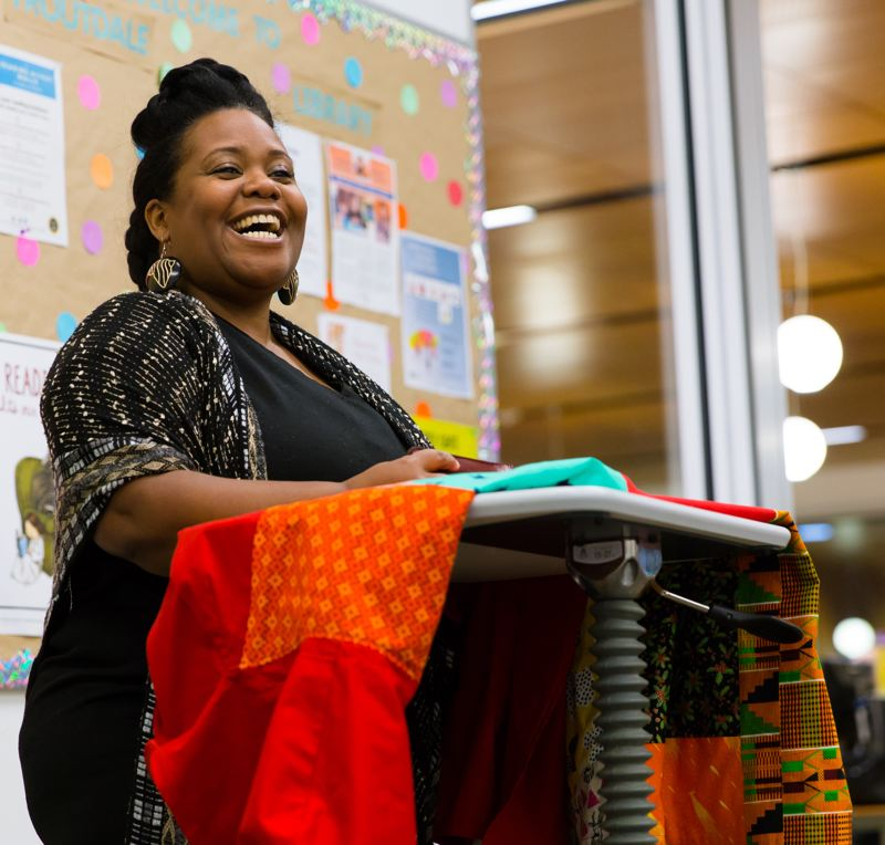 CONTRIBUTED: SIMSSHOT PHOTOGRAPHY - Shalanda Sims during a reading of her new children's book, 'Night Rhythms,' at the Gresham Library on Saturday, Dec. 9.
