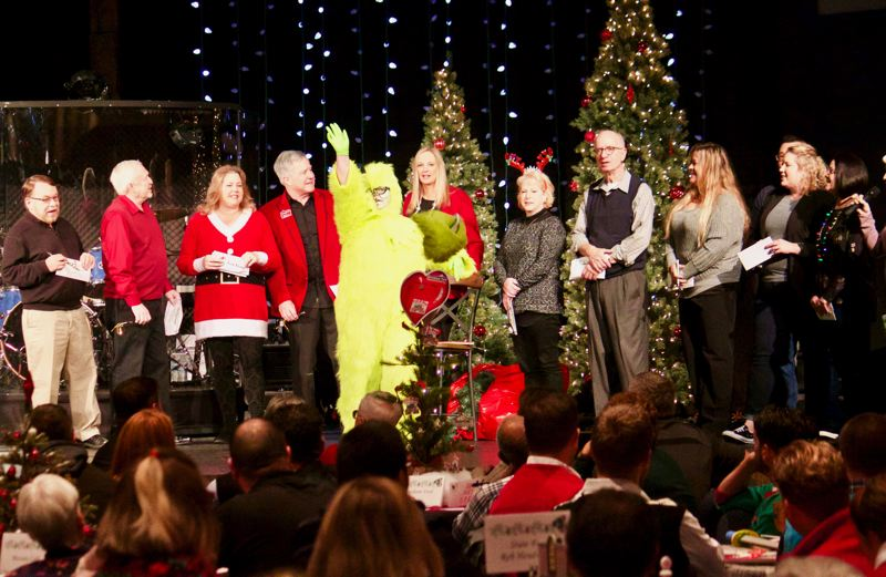 OUTLOOK PHOTO: CHRISTOPHER KEIZUR - The Gresham Area Chamber of Commerce held its Christmas Breakfast to help raise donations to support three local nonprofit organizations.