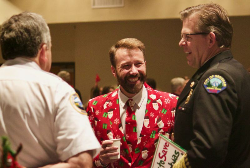 OUTLOOK PHOTO: CHRISTOPHER KEIZUR - Gresham Mayor Shane Bemis was recognized for his ugly Christmas zoot suit during the charity breakfast event.