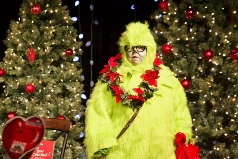 OUTLOOK PHOTO: CHRISTOPHER KEIZUR - Bess Wills of Gresham Ford dressed as the Grinch. As the event went on, her heart grew from the generosity of the local community.