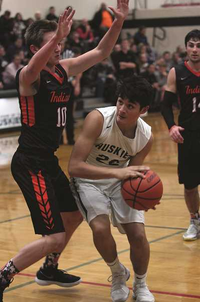 PHIL HAWKINS - North Marion sophomore Sergio Jimenez had 14 points and 11 rebounds on Friday against Scappoose.