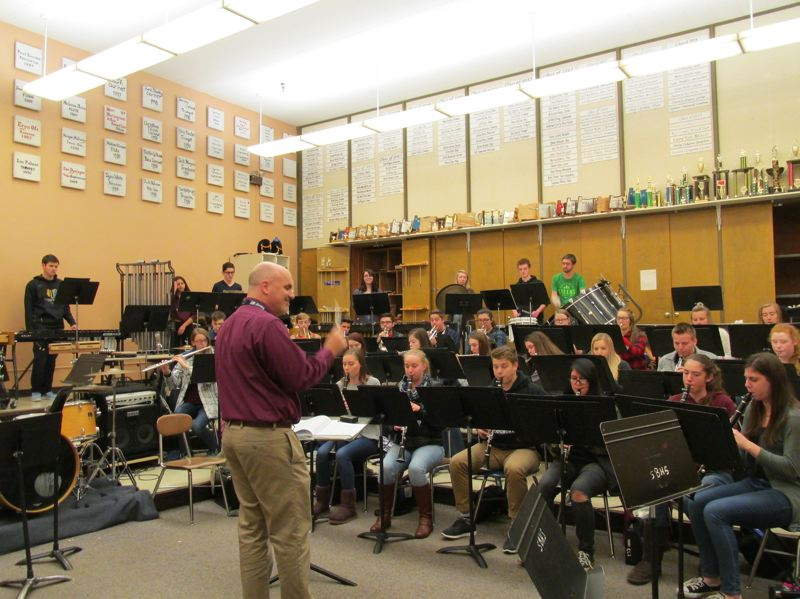 OUTLOOK PHOTO: TERESA CARSON - Paul Nickolas, director of the Barlow bands, puts the Symphonic Band through its paces to get ready for the Dec. 14 concert.