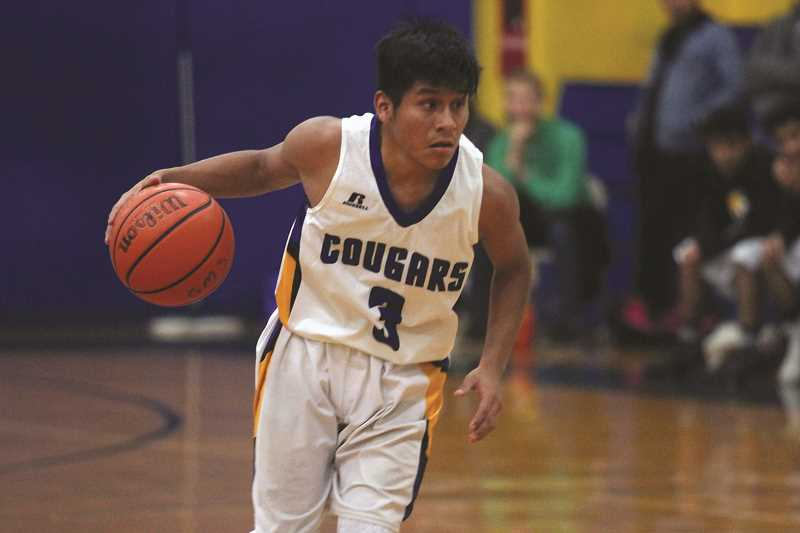 PHIL HAWKINS - Daniel Hernandez hit a pair of the Cougars' eight 3-pointers against Sheridan on Friday.