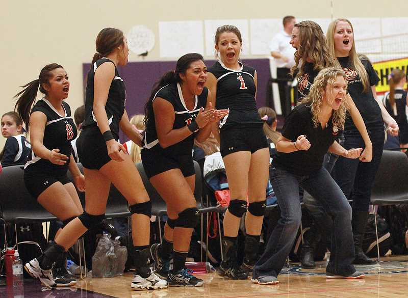 PIONEER FILE PHOTO - In eight years as head volleyball coach, Randi Viggiano (front right), guided the Bulldogs to seven straight 2A State Volleyball Championships, and finished third or higher in five of them, including the 2013 team that finished third, pictured at right. The Bulldogs won a state title in 2012. Her final season, Culver took second at state.