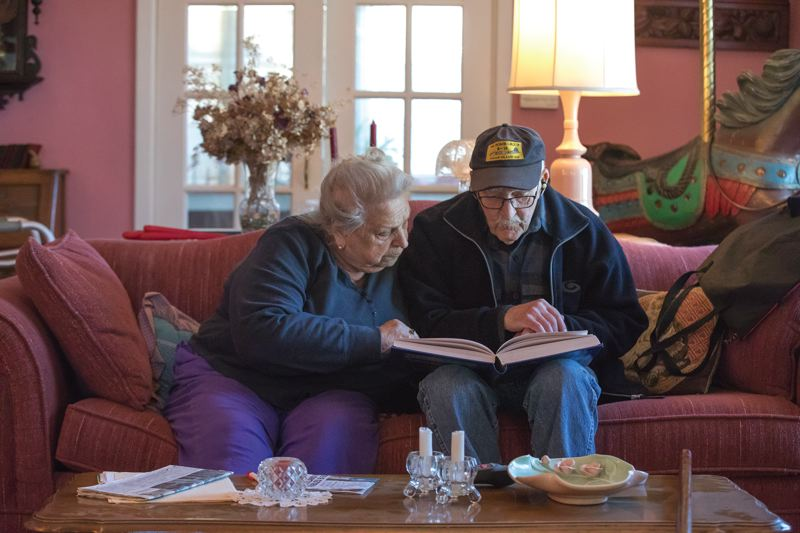 PORTLAND TRIBUNE: JONATHAN HOUSE - Anna Donner and Jack Cramer look through a history book about WWII. Cramer was a navigator in a B-29 Superfortress and so was one of Donner's cousins.