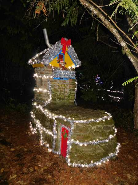ESTACADA NEWS PHOTO: EMILY LINDSTRAND - This festive holiday structire is one of many found along the Wenzel Farms Fantasy Trail.