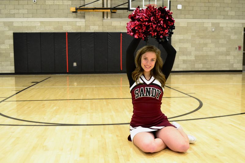 POST PHOTO: BRITTANY ALLEN - Taylor McMahon loves the leadership experience she gets from cheering.