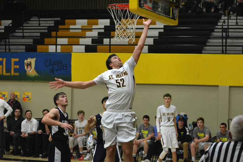 SPOTLIGHT PHOTO: JAKE MCNEAL - St. Helens senior forward Jacob Falk (52) lays up two of his 27 points.