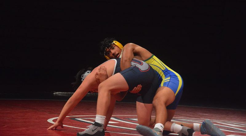 TIMES PHOTO: MATT SINGLEDECKER - Aloha 160-pound Ismael Garcia was one of seven straight Warriors to win against Westview last week.