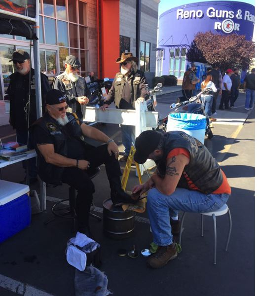 PHOTO COURTESY: KATHRYN EASTWOOD - Troy Eastwood shines a fellow Black Sheep rider's shoes in Reno, Nevada during a 'Street Vibrations' ride. This is a form of 'Jesus washing the feet of the disciples' or foot-washing in our current generation.