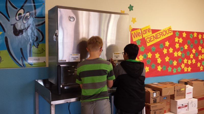 COURTESY CANBY SCHOOL DISTRICT - Students at William Knight Elementary in Canby fill their own milk from a brand-new dispenser, an anomaly in Oregon public schools. Canby hopes to see the initiative grow, to reduce both milk carton trash and wasted milk.