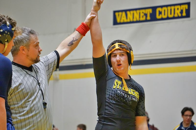 PHOTO CREDIT: AMY GADBOIS - Lions freshman Dylan Scott celebrates on the way to fourth at 182 pounds in the Springfield Tournament.