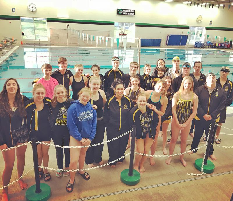 PHOTO CREDIT: CHELSIE ORR - The Lions boys' and girls' swim teams pose for a photo in their season opener at Parkrose.