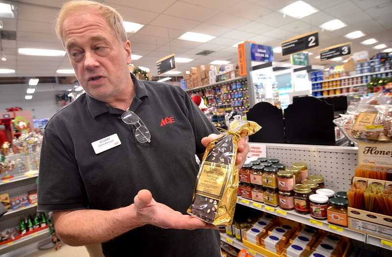 Stuart Dunis shows a bag of specialty candy which has been added to the product list at Lake Oswego Ace Hardware.