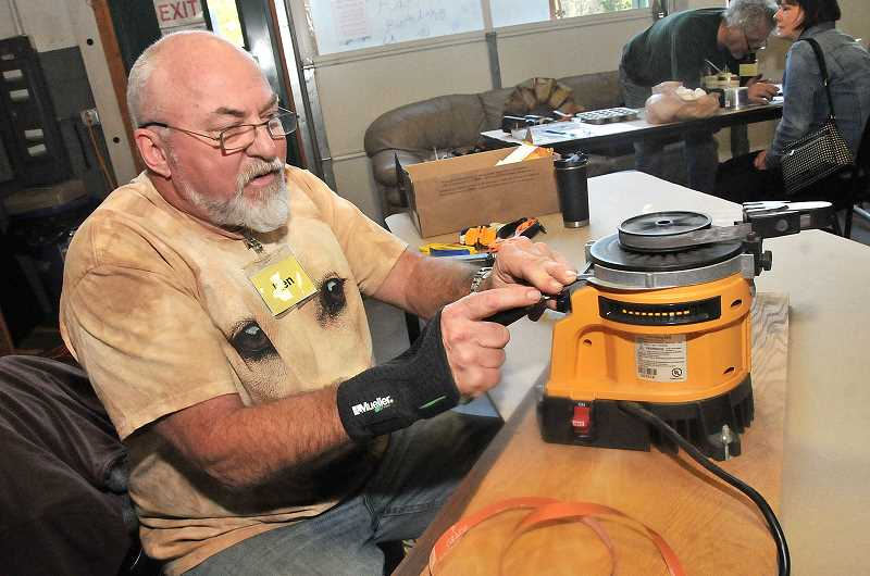 TIDINGS PHOTO: VERN UYETAKE - Ken Clifton works on sharpening tooling at Saturdays repair fair.