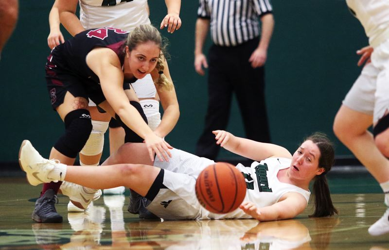 DAN BROOD - Sherwood junior Cali Etherington (left) and Tigard junior Paige LaFountain battle for a loose ball in Monday's game.