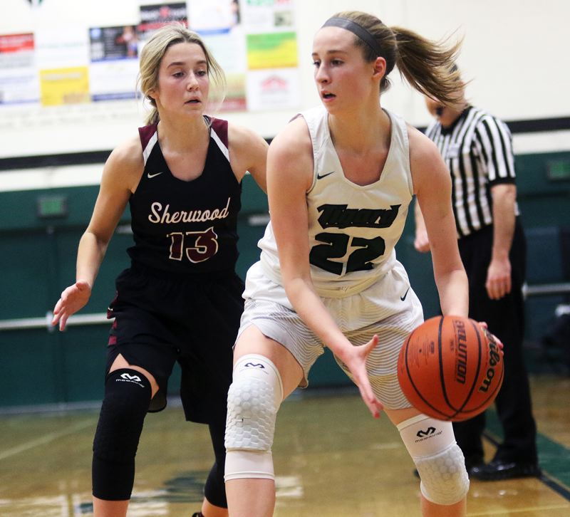 DAN BROOD - Sherwood High School senior Lauren Scarvie (left) plays strong defense against Tigard sophomore Delaney Leavitt during Monday's Three Rivers League opener.