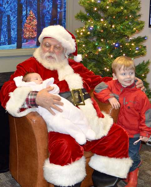 PIONEER PHOTO: CINDY FAMA - Sophia Fosmark (3 months) and her brother Elliot visit Santa at the tree lighting event.