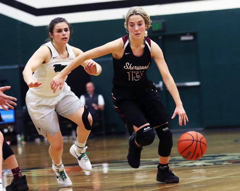 DAN BROOD - Sherwood senior Lauren Scarvie (right) dribbles the ball against Tigard sophomore Kennedy Brown.