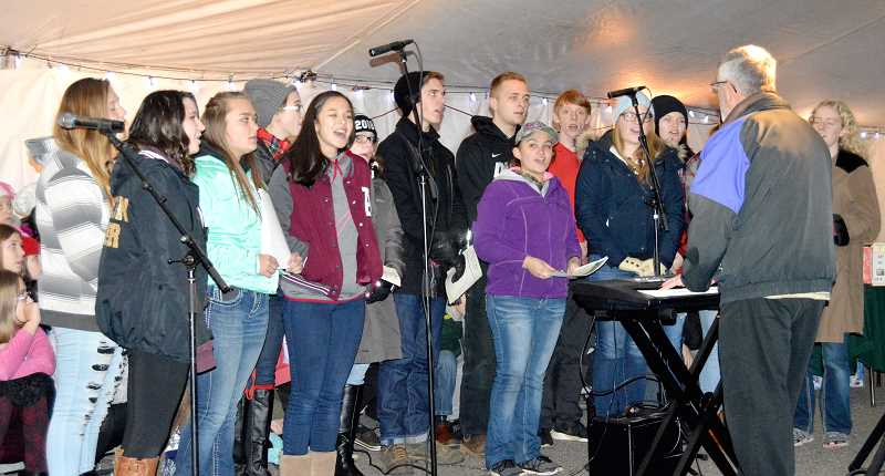 PIONEER PHOTO: CINDY FAMA - The CHS choir performed under the direction of Alan Bruner on Thursday at the tree lighting.