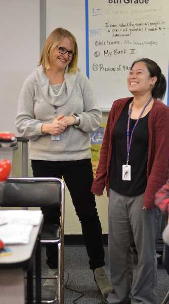 SPOKESMAN PHOTO: CLARA HOWELL - Inza R. Wood Principal Kelly Schmidt (left) honors teacher Meredith Wood (right) for saving a student's life.