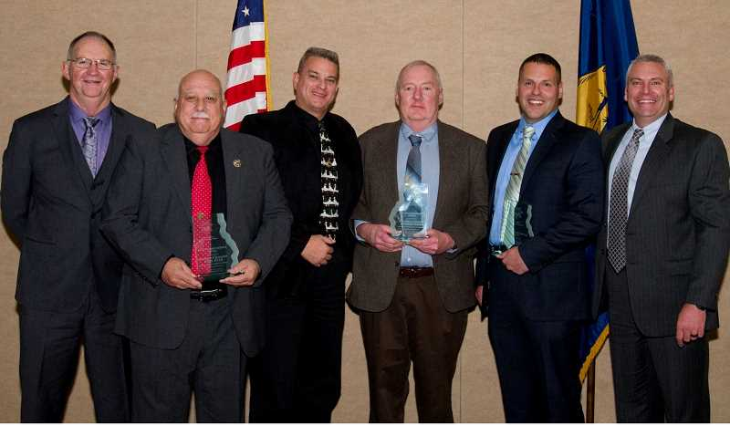 SUBMITTED PHOTO - Emergency managers from the tri-county area were honored with the Distinguished Service Award at the annual meeting of the Oregon State Sheriffs' Association Dec. 6. The emergency managers and their respective sheriffs are, from left, Crook County Sheriff John Gautney, Crook County Emergency Manager Michael Ryan, Jefferson County Sheriff Jim Adkins, Jefferson County Emergency Manager Mark Carman, Deschutes County Emergency Manager Nathan Garibay, and Deschutes County Sheriff L. Shane Nelson.