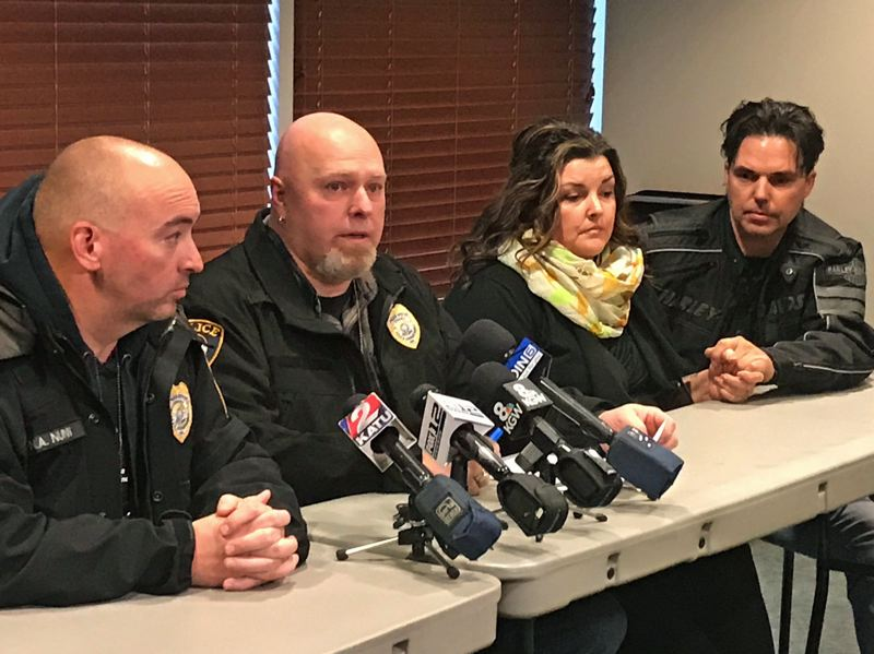 TIMES PHOTO: DANA HAYNES - Officer Nick Nunn, left, and Detective Jeff Hering speak to media Friday at Legacy Emanuel Hospital, regarding the status of injured officer Matt Barbee. Also at the conference were Barbee's wife, Sherrie Barbee, and brother-in-law, Brooks Utley.