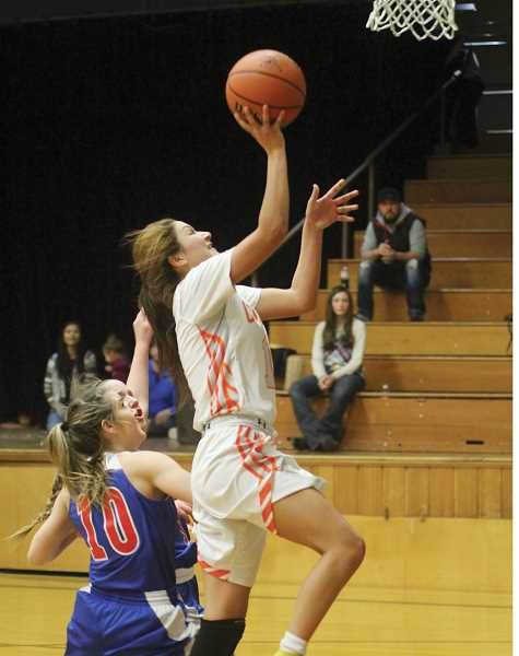 WILL DENNER/MADRAS PIONEER - Culver junior Irma Retano was a force in transition Friday night, finishing with 22 points, seven rebounds and six steals.