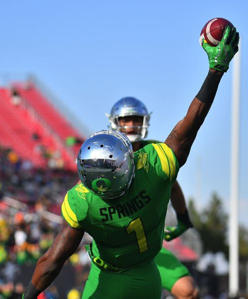 TRIBUNE PHOTO: SAM WASSON - Cornerback Arrion Springs intercepts a pass for Oregon in the Las Vegas Bowl.