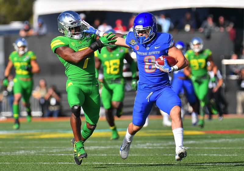 TRIBUNE PHOTO: SAM WASSON - Boise State receiver Sean Modster stiff-arms Oregon cornerback Ugochukwu Amadi.