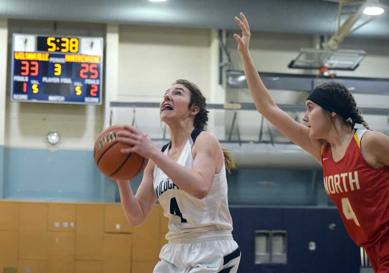 SPOKESMAN PHOTO: TANNER RUSS - Junior Teagan McNamee is a workhorse on the team, both offensively, and when she plays D. She contributed to the teams 61-36 success against North Eugene on Dec. 12.
