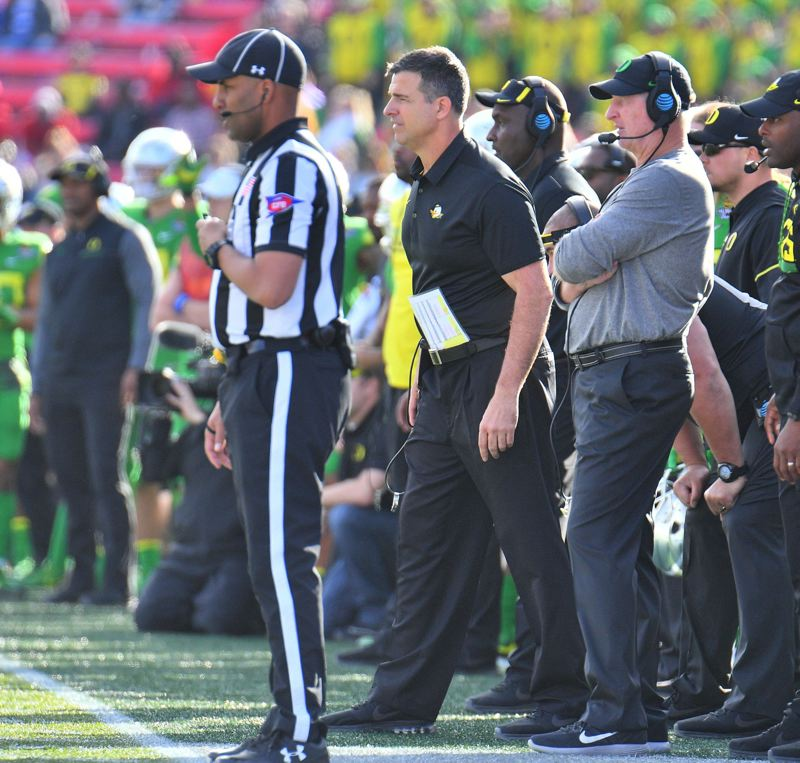 TRIBUNE PHOTOS: SAM WASSON - New Oregon coach Mario Cristobal watches with defensive coordinator Jim Leavitt (right) as the Ducks fall to Boise State 38-28 in the Las Vegas Bowl.