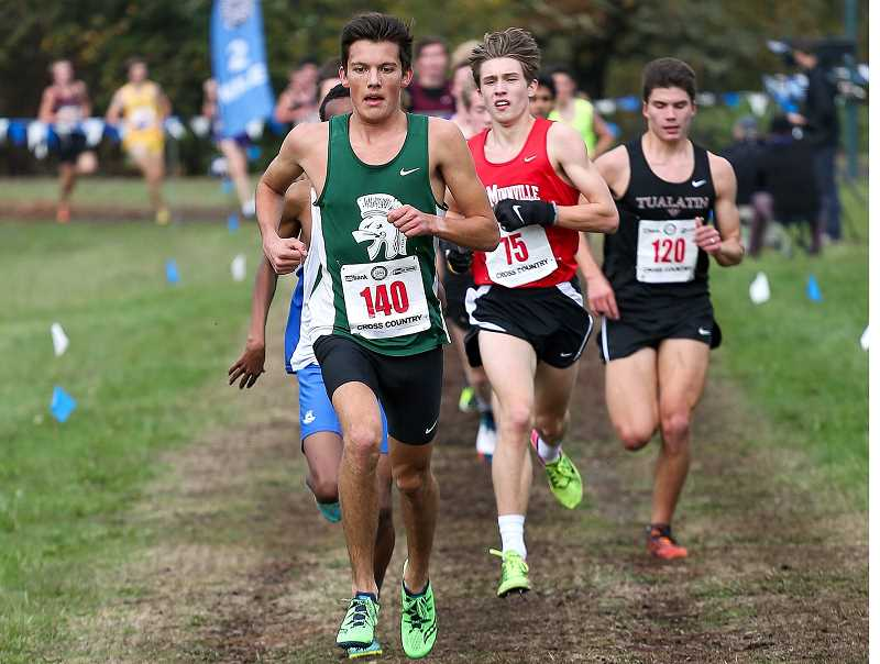 PAMPLIN MEDIA GROUP PHOTO: ADAM WICKHAM - Wilson High senior Alex Slenning leads the pack during the 6A Oregon State Championships in Eugene.
