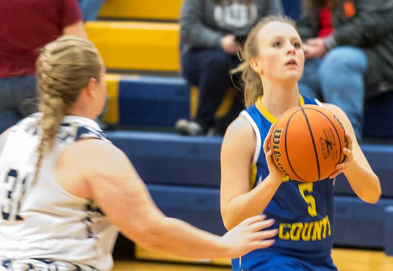 CENTRAL OREGONIAN FILE PHOTO - Teagan Freeman goes up for a 3-point shot during a game earlier this year. Freeman scored 11 points Thursday to lead the Cowgirls in a 51-33 loss to Seaside.
