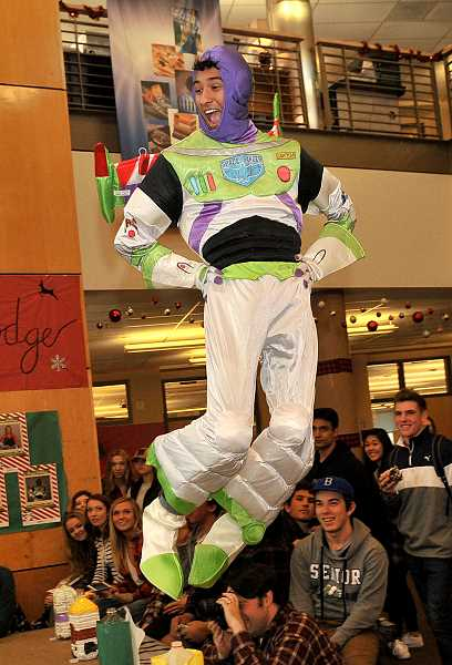SPOKESMAN PHOTO: VERN UYETAKE  - Anthony Baltazar does his best Buzz Light Year impression.