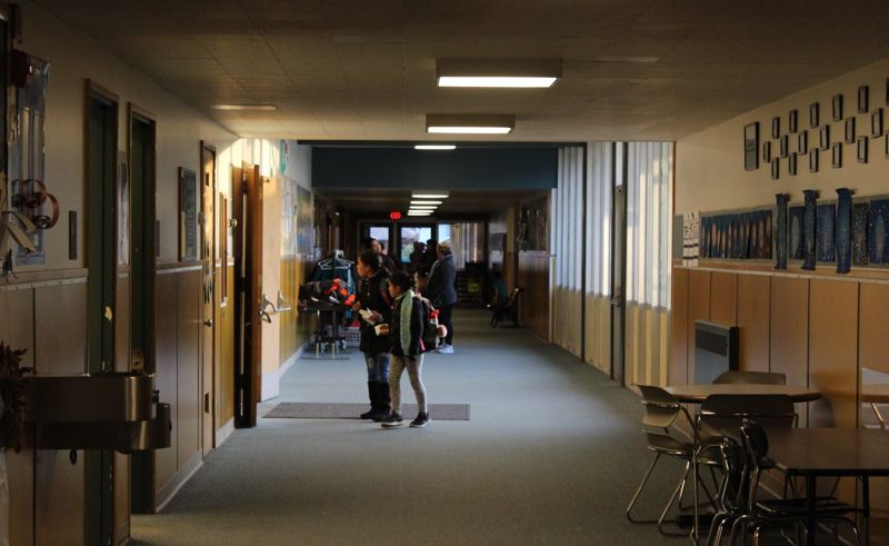 PHOTO BY: MADISON DALLING-RAISNER - Students at Lot Whitcomb Elementary School make their way through hallways of the 1958 building that soon will get a major renovation.