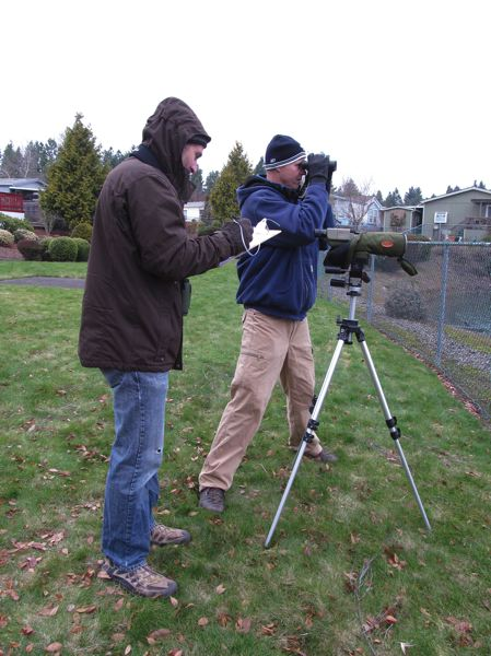 PHOTO BY ELLEN SPITALERI - Ron Myers, left records the number of birds seen by Dan Strong at a site in Milwaukie behind La Salle Prep at last year's Christmas Bird Count. This years count is set for Dec. 30.