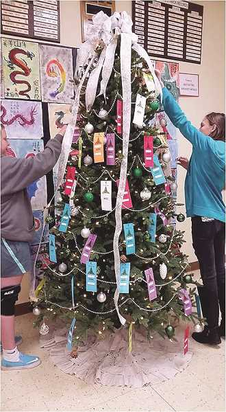 COURTESY PHOTO: NORTH MARION MIDDLE SCHOOL - Students at North Marion Middle School decorate the Giving Tree in the school's main hall.