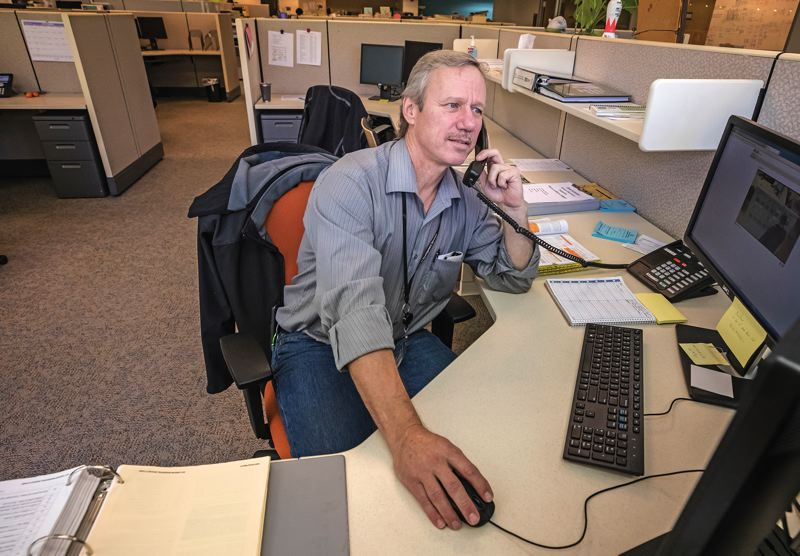 PAMPLIN MEDIA GROUP: JONATHAN HOUSE - Dave Scranton, senior electrical inspector for the City of Portland at his office.
