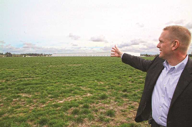 INDEPENDENT FILE PHOTO - Todd Sheaffer, president of Specht Development Inc., pictured in 2016 soon after the Woodburn UGB expansion became finalized. The property he is pictured gesturing to will be annexed into the city, an accomplishment that comes as the result of a yearslong legal battle.