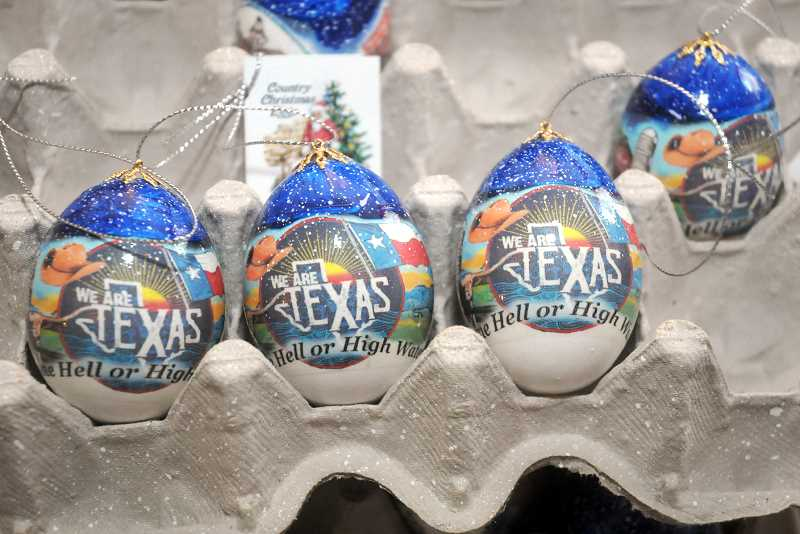 """GARY ALLEN - The special fundraiser ornament features the same design from the """"We Are Texas"""" fundraiser t-shirt, along with an original Texas Christmas scene designed by artist Dan Stevens."""
